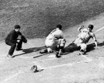 High-angle view of American baseball player Joe DiMaggio (1914 - 1999) (right) of the New York Yankees as he slides into home plate while Ernie Lombardi (1908 - 1977), catcher for the Cincinatti Reds tries unsucessfully to stop hims from scoring during game four of the World Series, at Crosley Field, Cincinatti, Ohio, October 8, 1939. The Yankess won went on to win both the game and the series. (Photo by Bruce Bennett Studios/Getty Images)